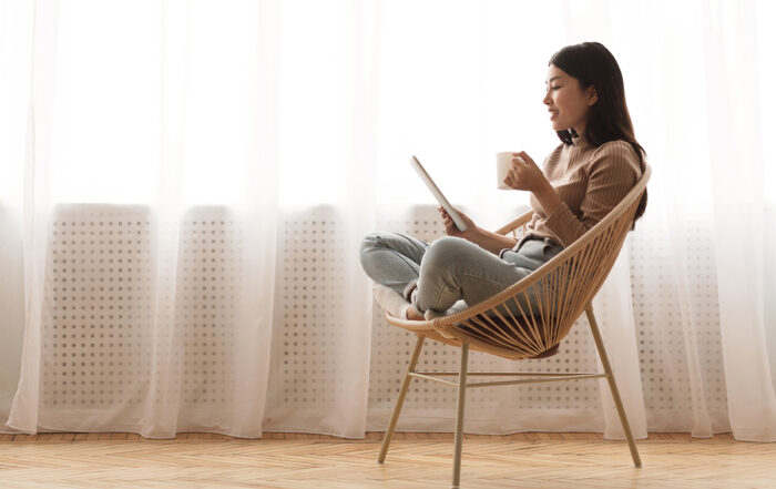 Young Asian woman reading tablet