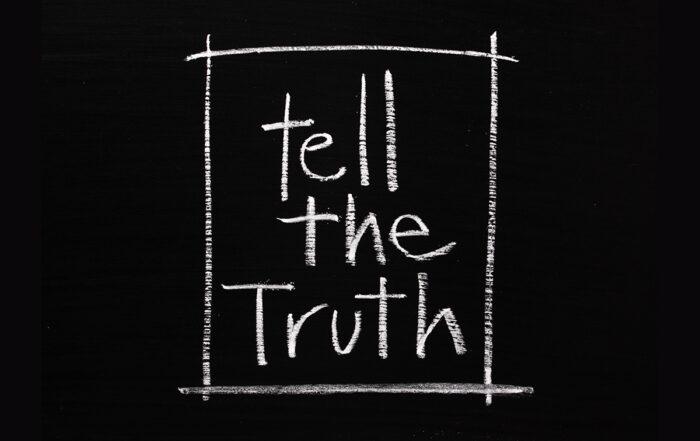 Tell the Truth written in white chalk on a blackboard